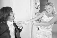 Girl pulling a groom by tie